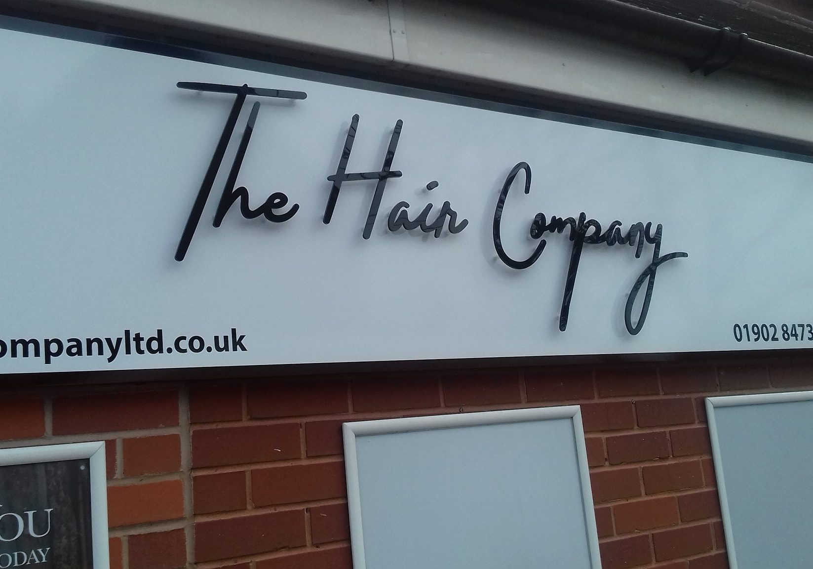 The Hair Company salon sign